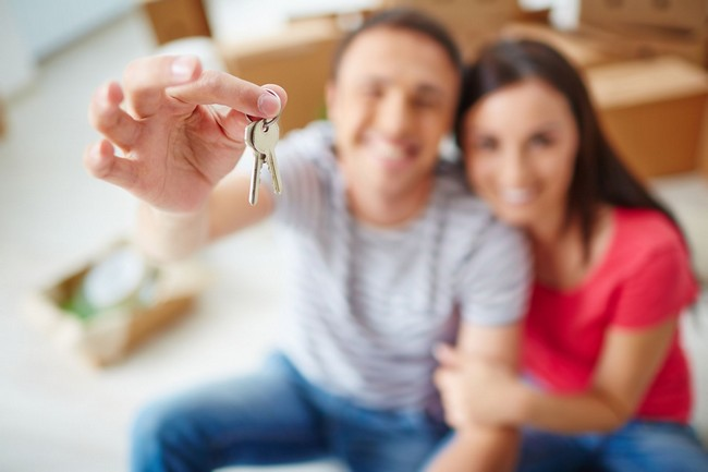 Blurred couple holding keys