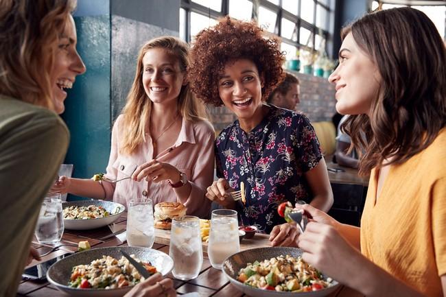 Women enjoying food at table