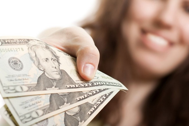 Money with smiling woman in background