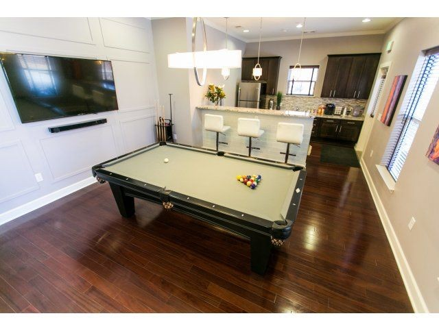 Billiards table and view of kitchen area
