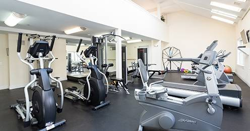 State of the art fitness center with cardio and strength training equipment and TV's