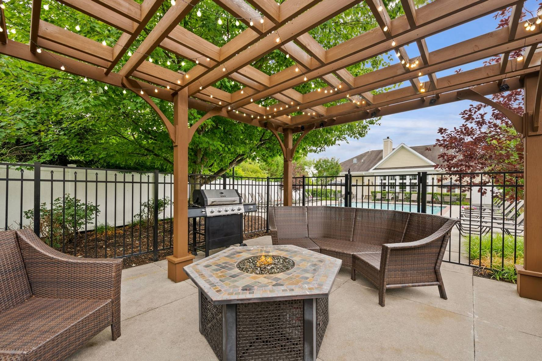 Outdoor seating area with firepit and grill station