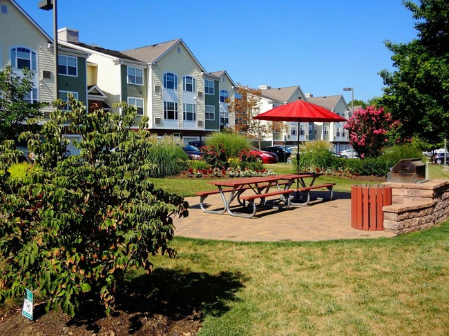 Outdoor picnic area with view of apartment building