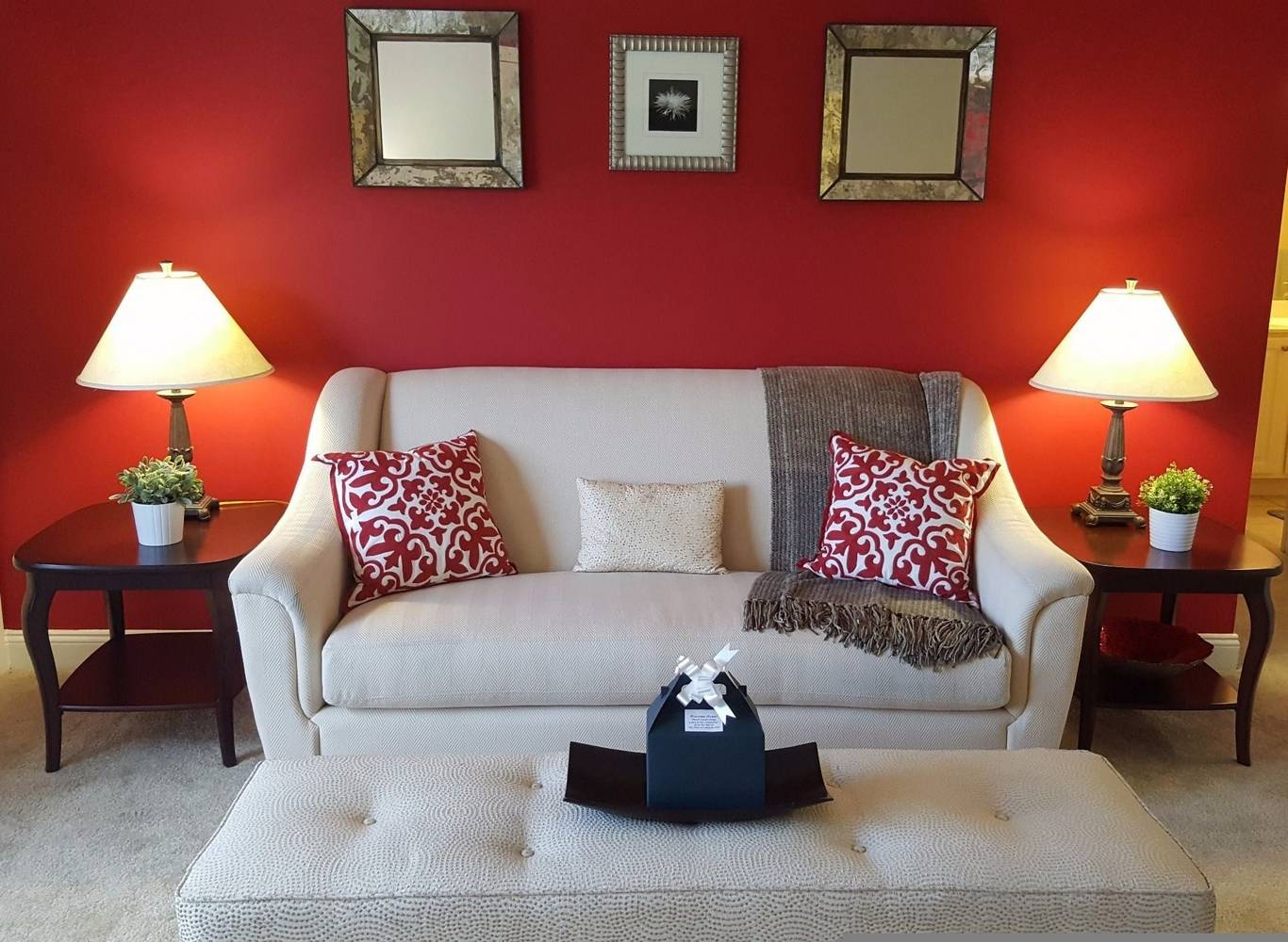 Red living area with white couch