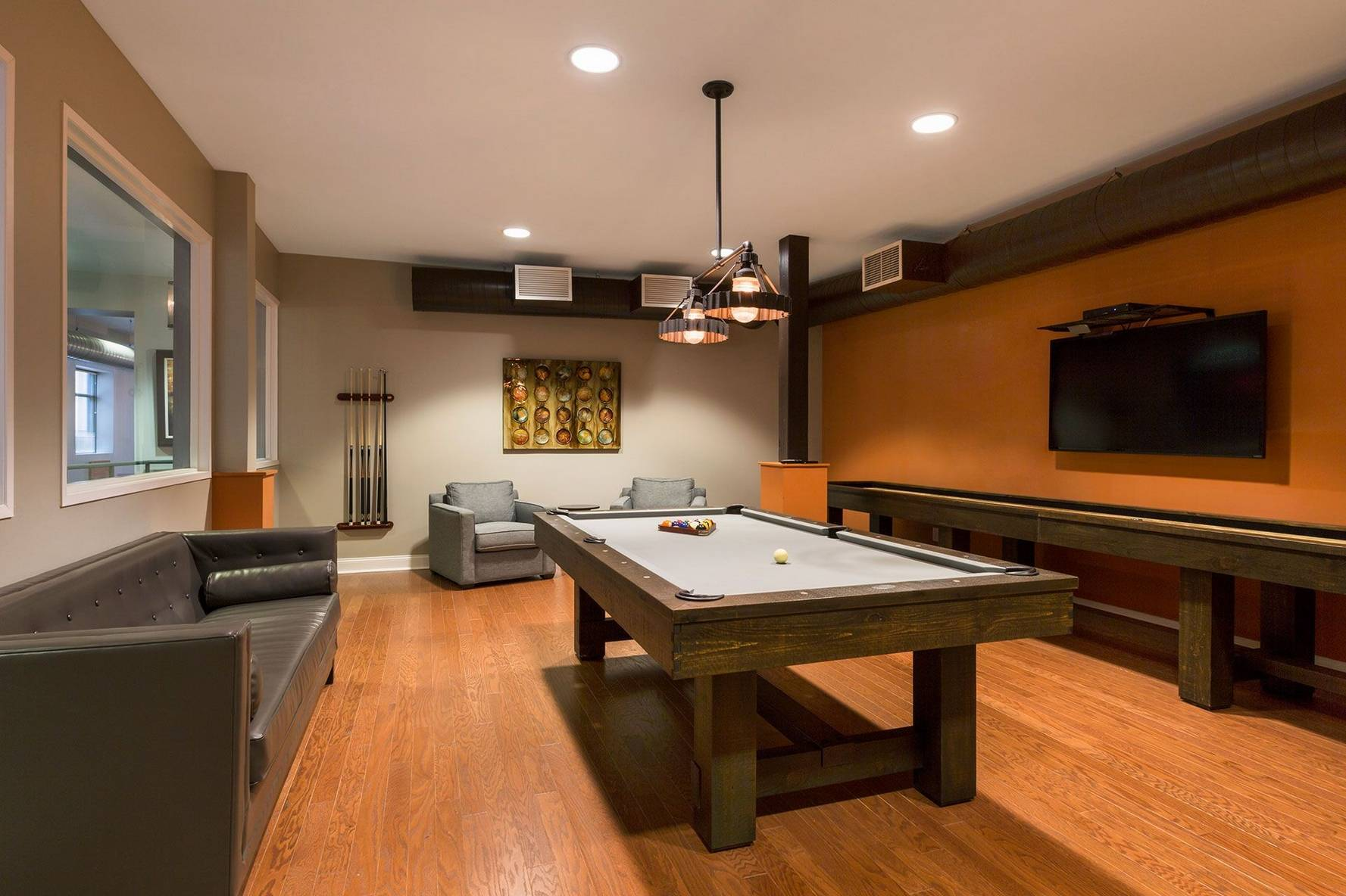 Game room with pool table and shuffleboard