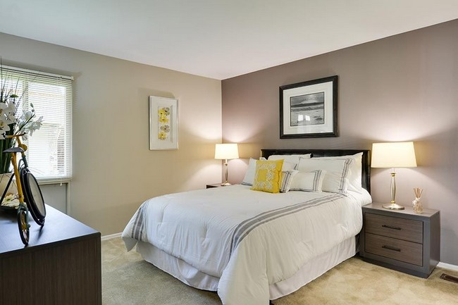 bedroom with light bedding and furniture